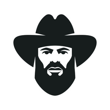 Bearded cowboy in a hat. Cool American man