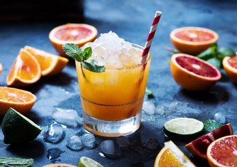Refreshing cocktail with crashed ice, juicy summer drink with citrus fruits