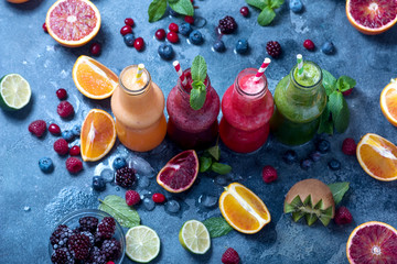 Bottles with different colorful smoothies, healthy drink with berries and fruits, healthy lifestyle