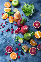 Colorful detox smoothie in bottles, summer diet fresh drink for breakfast or snack.