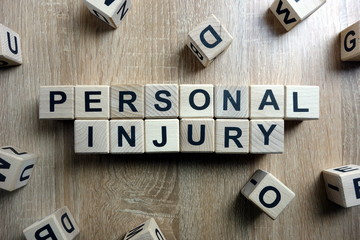 Personal injury text from wooden blocks on desk