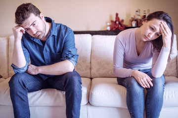 Sad couple with problems at home feeling bad