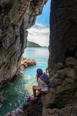 Travel people women tourist in a cave near the sea in Keo Sichang, holiday and vacations tourist, Thailand. Travel Summer Concept