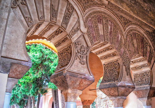 Arabian arch in Nasrid Palace. Arcade with Arabian ornaments in Alcazaba de Malaga, Andalucia, Spain
