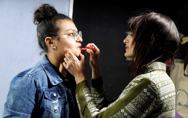 "Palestinian girl has her makeup applied as she prepares to act in a play titled ""Us Too, Women of Palestine"", inspired by Greek tragedian Aeschylus's ÒThe Suppliant WomenÓ, in Ramallah, in the Israeli-occupied West Bank"