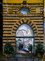 Night view of the ancient oratory in the historic center of Pistoia, Tuscany, Italy, now historical Caffé Valiani