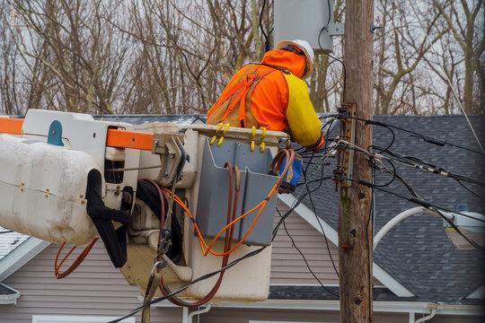 Electrical lines service men handling damage after hurricane