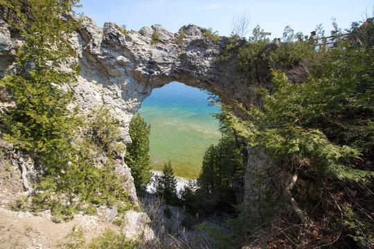 Mackinaw Island Arch Rock. The famous natural landmark Arch Rock is an ancient geological formation on the coast of Lake Huron  on Mackinac Island in Michigan.