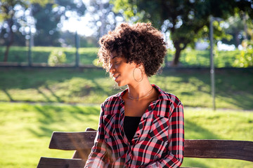 Close up portrait of an attractive african brazilian woman on the park - Imagem