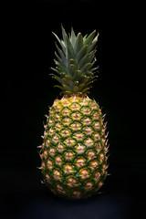 Fresh pineapple on black background - isolated
