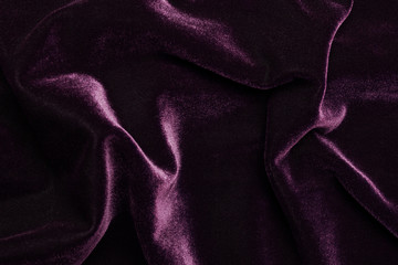 Beautiful luxury dark purple velvet texture background cloth.