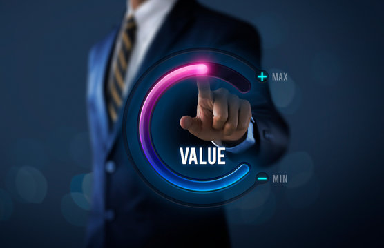 Growth value, increase value, value added or business growth concept. Businessman is pulling up circle progress bar with the word VALUE on dark tone background.