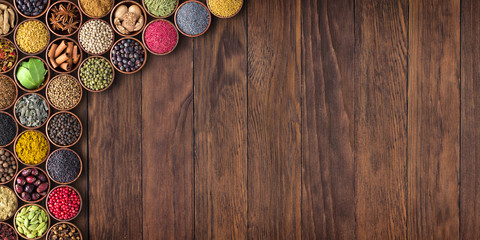 Fototapete - Indian spices and herbs on wooden table.Condiment collection with empty space