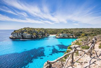 Beautiful bay with sandy beach and sailing boats, Menorca island, Spain Fototapete