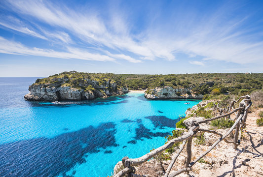 Beautiful bay with sandy beach and sailing boats, Menorca island, Spain