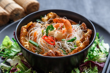 Close view of noodle salad with shrimps, vegetables and omelette, thai cuisine