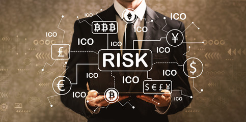 Cryptocurrency risk theme with businessman holding a tablet computer on a dark vintage background