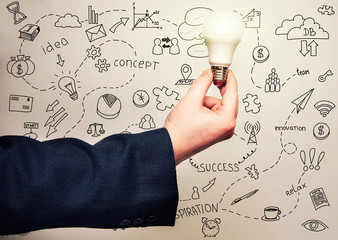Man holding a light bulb, an illustration of the concept of innovation and ideas.
