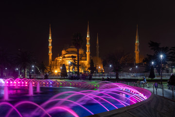 Colorful fountain and The Sultan Ahmed Mosque in Istanbul after the sunset
