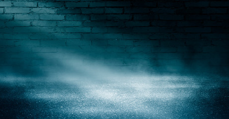 Background of an empty brick wall, illuminated by the light of a neon projector, concrete floor, smoke