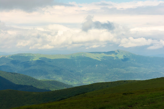 distant mountain ridge in clouds. beautiful summer landscape with cloudy weather