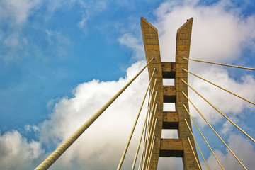 A bridge tower against the blue sky with white clouds. Lekki-Ikoyi toll bridge, Lagos, Nigeria. Nigerian landmark and skyline concept.