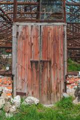 old rusty wooden door of greenhouse