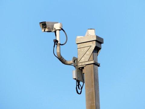 Surveillance cameras monitoring motorway traffic on the M25 in Hertfordshire, England, UK