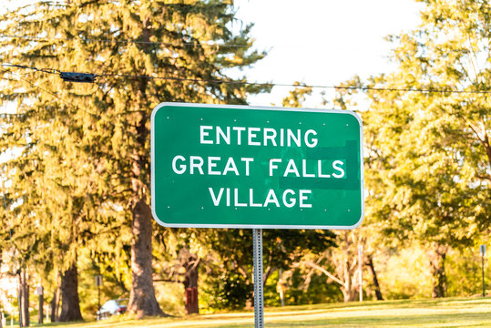 Great Falls, USA sign for Downtown in Northern Virginia city town with closeup in Fairfax county and trees in background