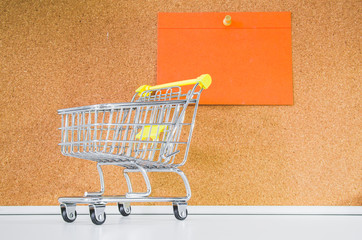 Mini shopping cart to illustrate the trade or distance selling