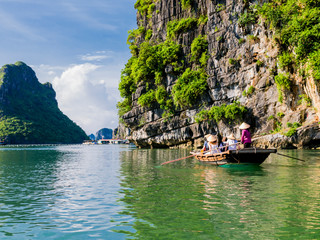 Tourists enjoying a boat trip through the limestone mountains of halong bay
