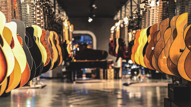 guitars, showcase with guitars hanging in a row