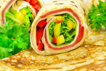 Pancakes filled with ham and vegetables