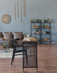 Modern home room, wooden desk and laptop style, decorative grey wall and brown sofa and bookshelf, gold lamp and book.