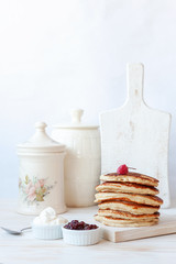 Delicious homemade pancakes with sour cream and jam.
