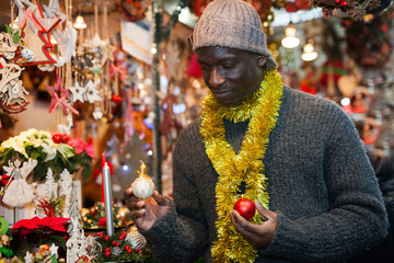 Man looking for New Year decorations