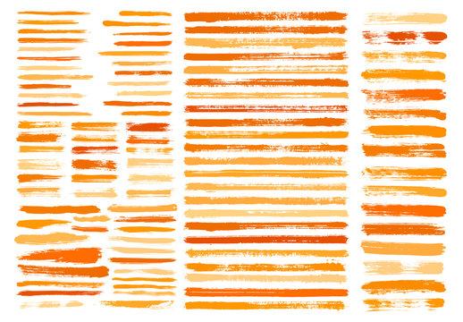 Orange paint stain brush stroke dabs set.