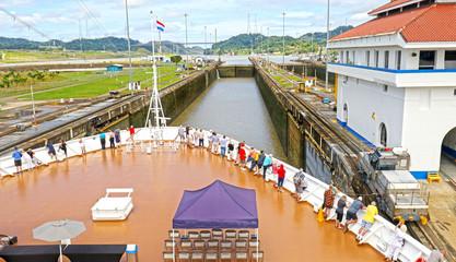 Cruise ship Approaching Locks at Panama Canal, Panama.  Unrecognizable People