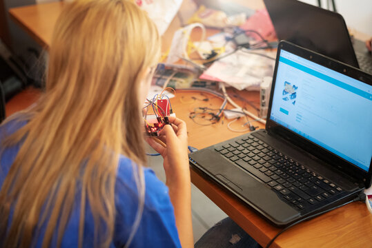 young girl building a computer controlled device