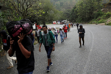 Honduran migrants walk toward the Agua Caliente border checkpoint as they continue their travel to the United States, in the municipality of Esquipulas