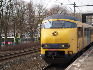 Mat '64 train along the platform of Gouda station in the Netherlands.
