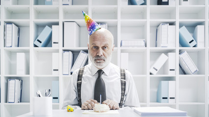 Senior businessman having a sad lonely birthday