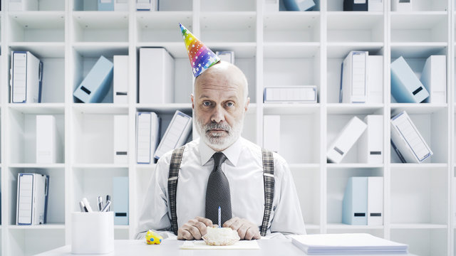 Senior businessman having a sad lonely birthday