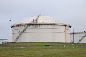 Big storage tanks on the oil refinery of BP in the port Rotterdam in the Europoort harbor