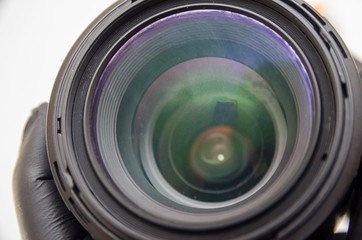 Photo lens or video lens close up on white background, goal, concept for photographer, cameraman, job, search for photographer, journalist, videographer for work. Photo lens repair