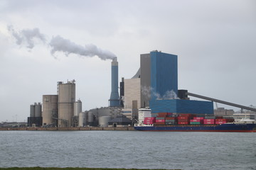 The coal energy power plant of Engie with steam coming out of the chimney.