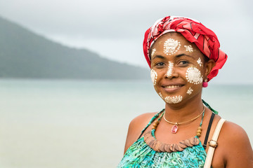 Portrait of a Malagasy woman with her face painted, Vezo-Sakalava tradition, Nosy Be, Madagascar. Wall mural