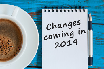 A note Changes coming in 2019. With morning coffee cup