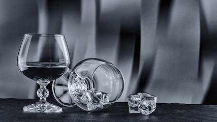 black white photo A glass of brandy Close-up