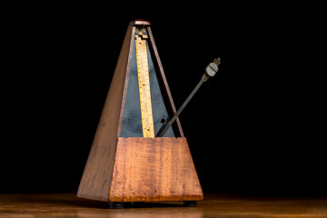 Detail of an old mechanic musical metronome